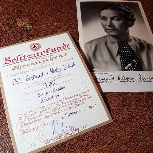 Award document for NSDAP Golden Party Badge (Goldene Ehrenabzeichen der NSDAP) awarded to Gertrud Scholtz-Klink