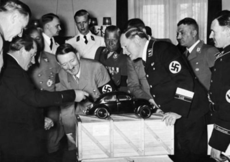 Adolf Hitler looking at KdF-Wagen (later VW Beetle) demonstration by Ferdinand Porsche