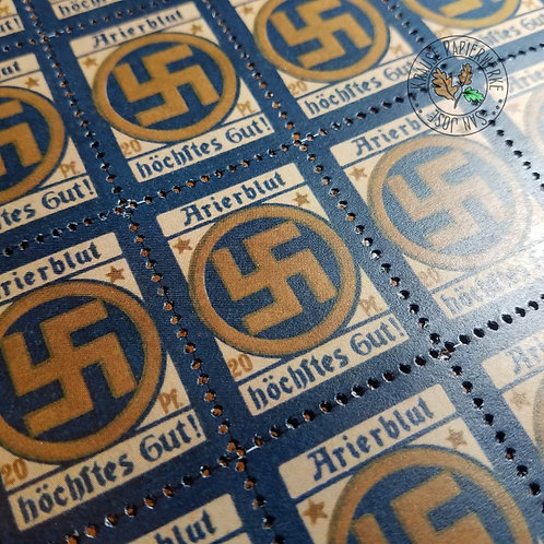 """Arierblut höchstes Gut!"" - ""Arian Blood - the highest good!"" Propaganda stamp from Nazi Germany with a large swastika."