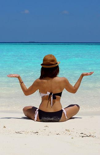 Woman finding balance on beach