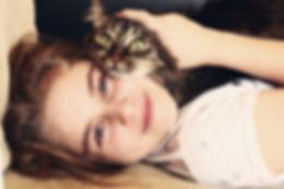 teenage girl hug cat close up portrait.j
