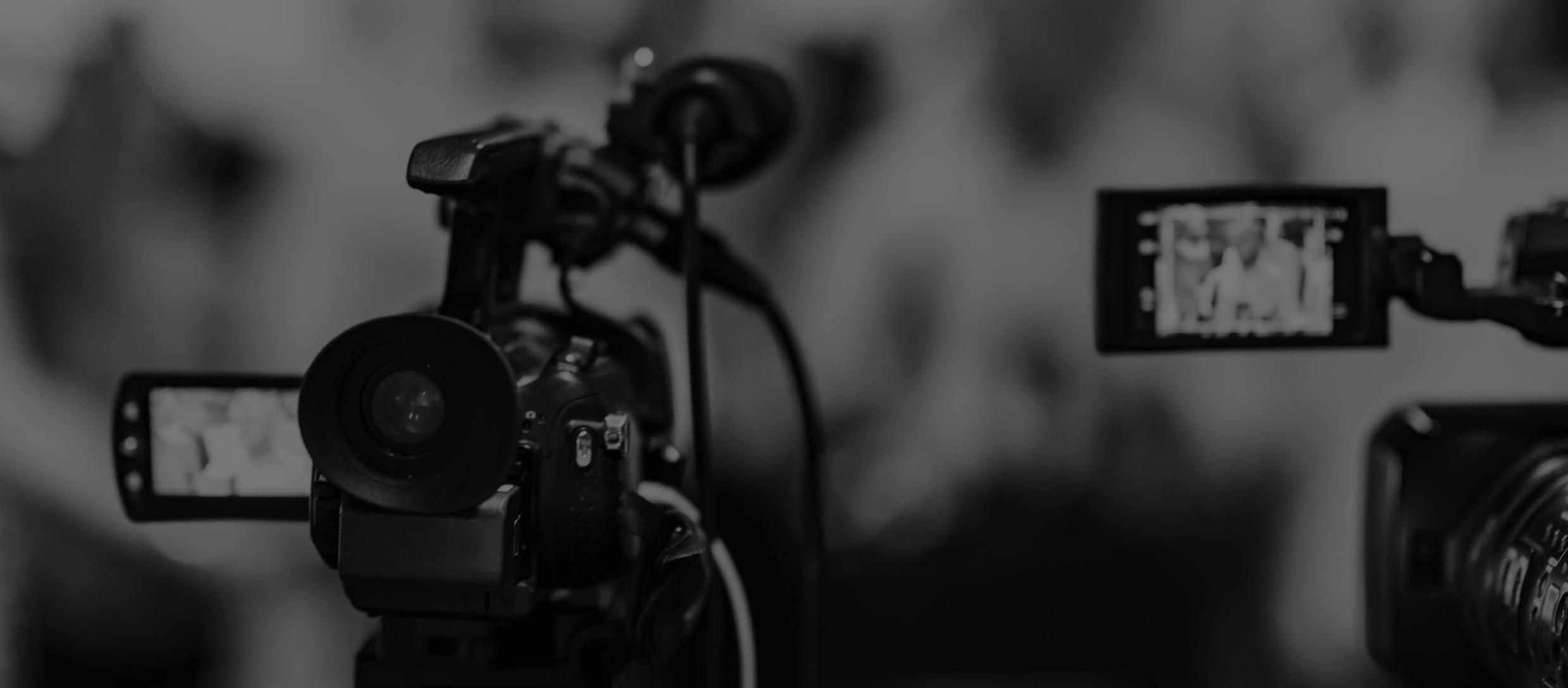 camera-at-media-conference-PCMUVRT_edite