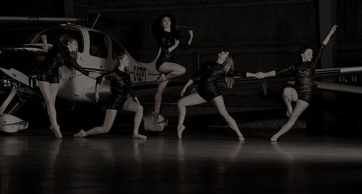 Contemporary dancers in hangar