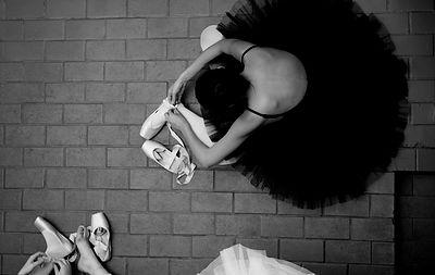 Ballerina black tutu sitting stretch
