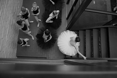 Ballet dancers climbing stairs for show