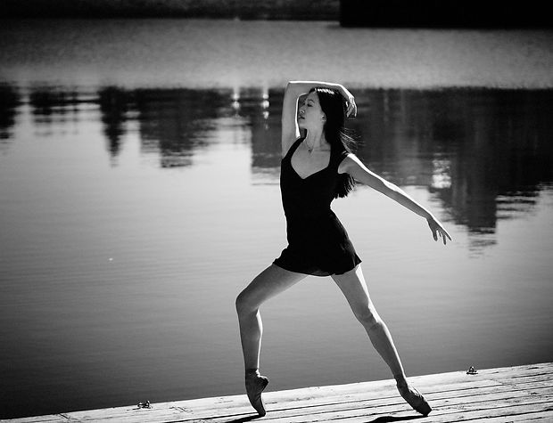Ballerina professional pose near water