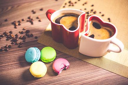 coffee-in-heart-cups-and-sweet-yummy-mac