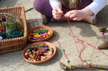 Earth Mobiles using found objects and twine and beads (age 5)