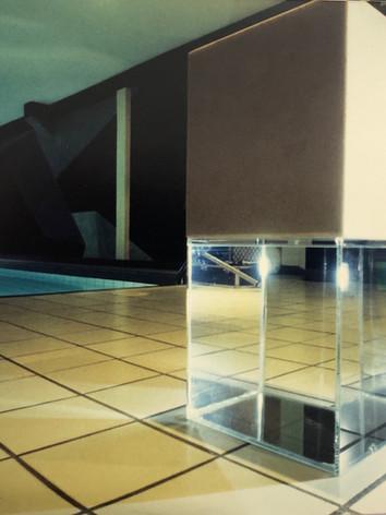 """Henome Ryna, 1993 by Brigitte NaHoN. Eau, verre, marbre de Thassos. Exposition """"Brigitte NaHoN"""" à la Galerie de l'Istitut Français, Thessalonique, 1993."""