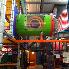Climb up the tunnel on the play frame at Head Over Heels Play Chorlton