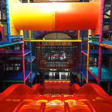 Slide down the big red slide at Head Over Heels Play Chorlton