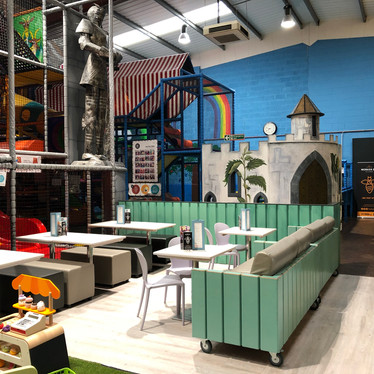 Relax on the comfy sofas whilst the children play at Head Over Heels Play Chorlton