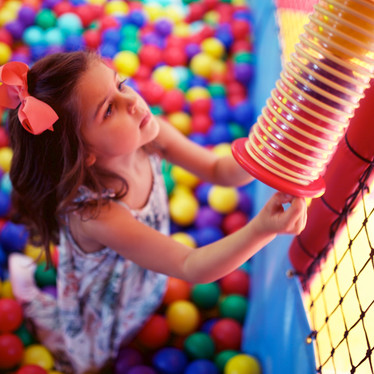 Fill the ball shower at Head Over Heels indoor play centre