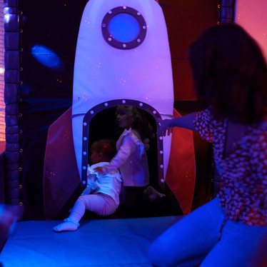 Climb inside the rocket in the space themed sensory room at Head Over Heels Play Chorlton