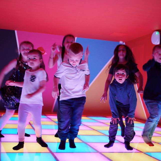 Children enjoy dancing on the LED dance floor at Head Over Heels Play Chorlton