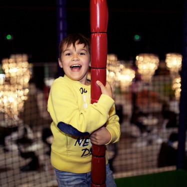 Boy enjoying energetic play at Head Over Heels Wilmslow
