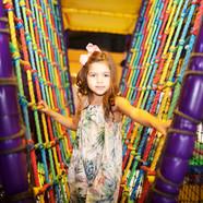Girl crossing the rope bridge at Head Over Heels Wilmslow