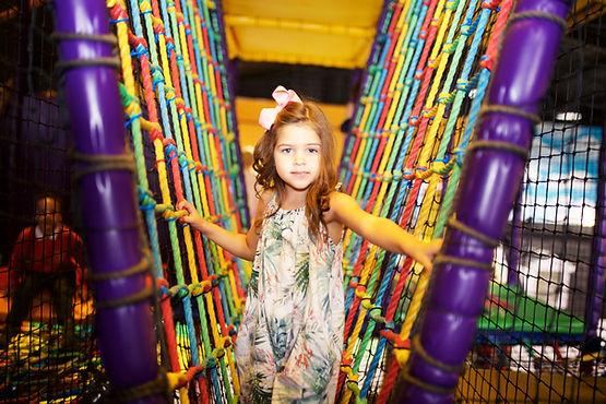 Girl playing on rope bridge at Head Over Heels Wilmslow