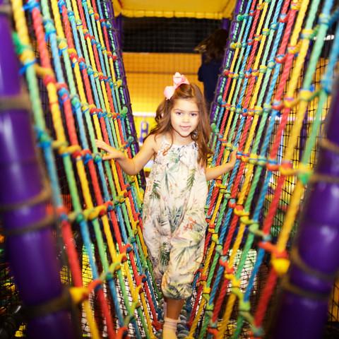 Climb across the rope bridge on the play frame at Head Over Heels Chorlton