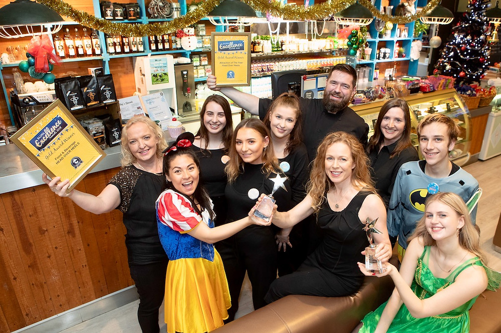 Head Over Heels Award Winning Team with owner Cathy Dunlevy
