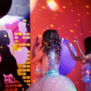 Girls dancing in the disco room at Head Over Heels Wilmslow