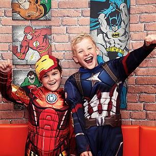 Boys in superhero costumes in Head Over Heels Wilmslow Super Hero Party Booth