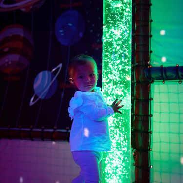 Watch the bubble tubes glow in the space sensory room at Head Over Heels Play Chorlton