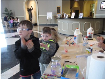 Kids get messy at the make your own bouncy ball station
