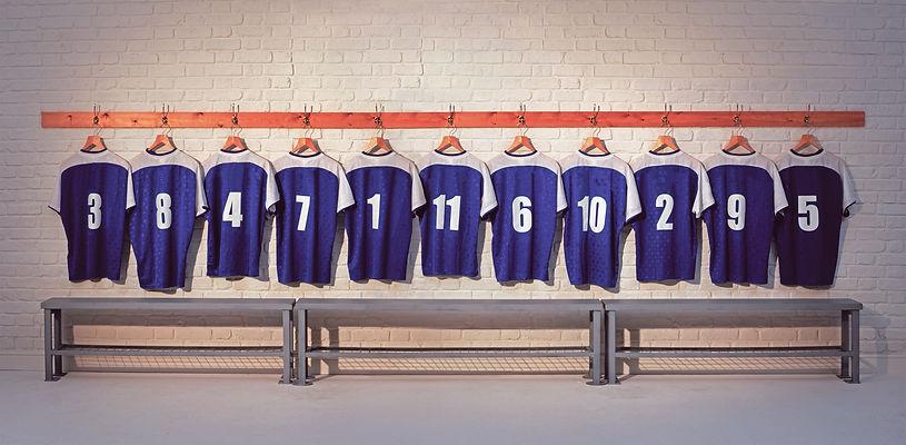 Football Team Shirts on locker room wall