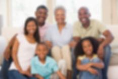 extended-family-in-living-room-smiling_S