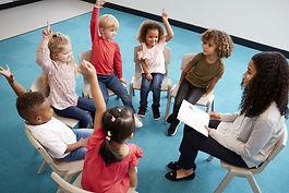 circle raising hands.jpg