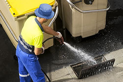sewerage worker cleaning sewer line.jpg