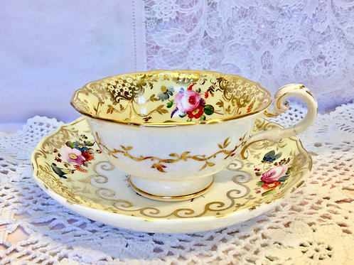 Coalport cup and saucer yellow ground with floral decoration c1840