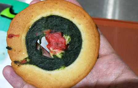 bulls eye cookie intact and in hand