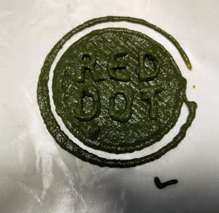 Raw Red Dot logo