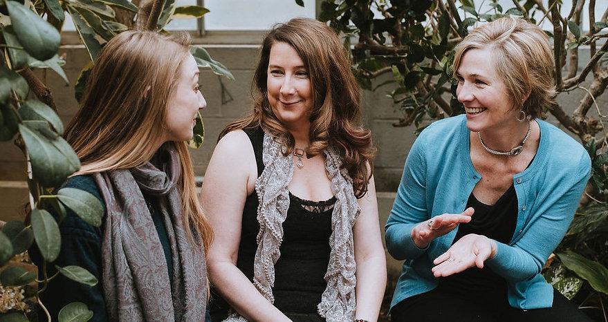 Three women enjoying a conversation