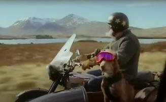 Cadbury Dairy Milk ad man and dog on motorbike riding in the Scottish highlands