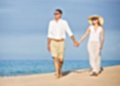 Happy senior couple on the beach. Retire