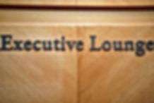 Signage of Executive Lounge on wooden ba