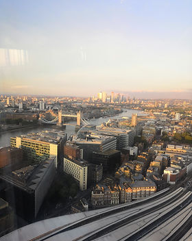 Rooftop view of London from the Shard at golden hour.