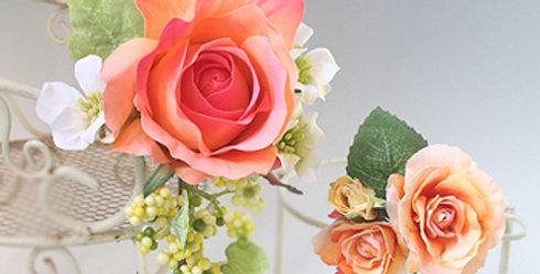 大きい髪飾りと小さい髪飾りのセットのバラの髪飾り