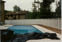 Ornamental Aluminum and PVC to Enclose Your Pool by Wayne's Fencing