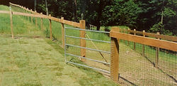 Wood Posts and Top Rail with 2 x 2 Woven Wire by Wayne's Fencing