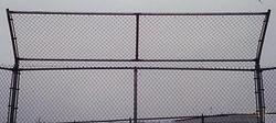 Baseball backstop overhangs by Wayne's Fencing