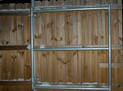 Wood to steel dumpster enclosures
