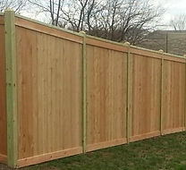 Capped and Trimmed Privacy Fence by Wayne's Fencing