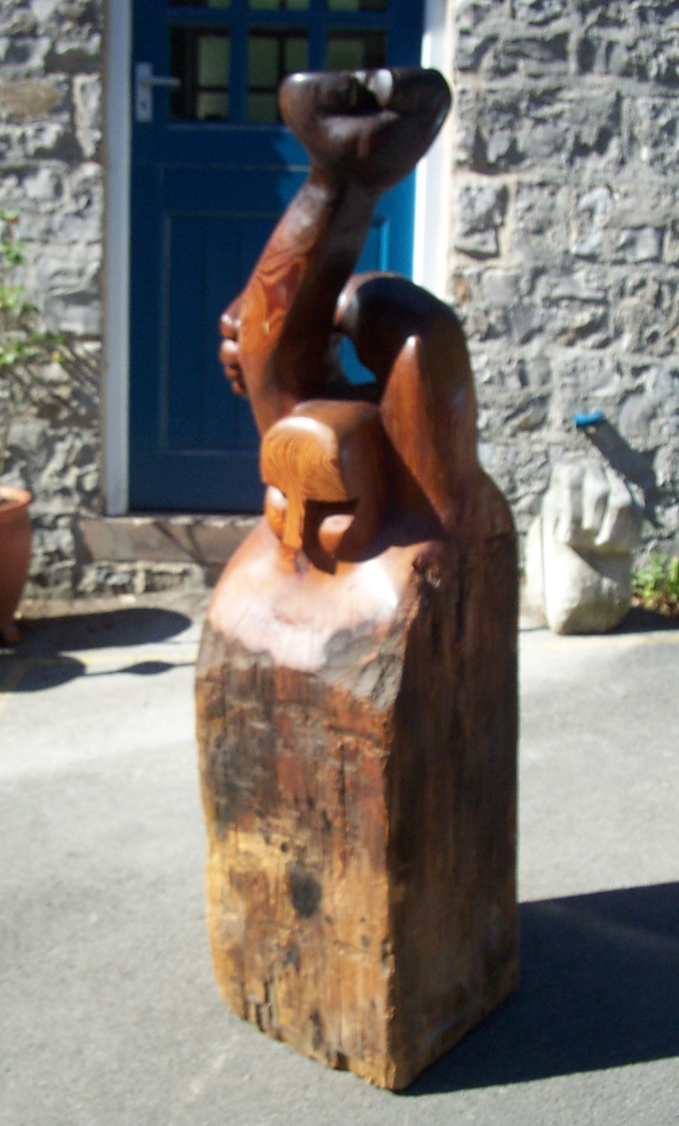 Jeff Perks- Raised Fist. Timber recovered from Surrey Docks.70x30x30cm