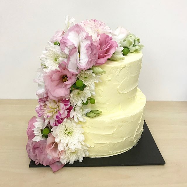Stunning two tier with fresh cascading flowers