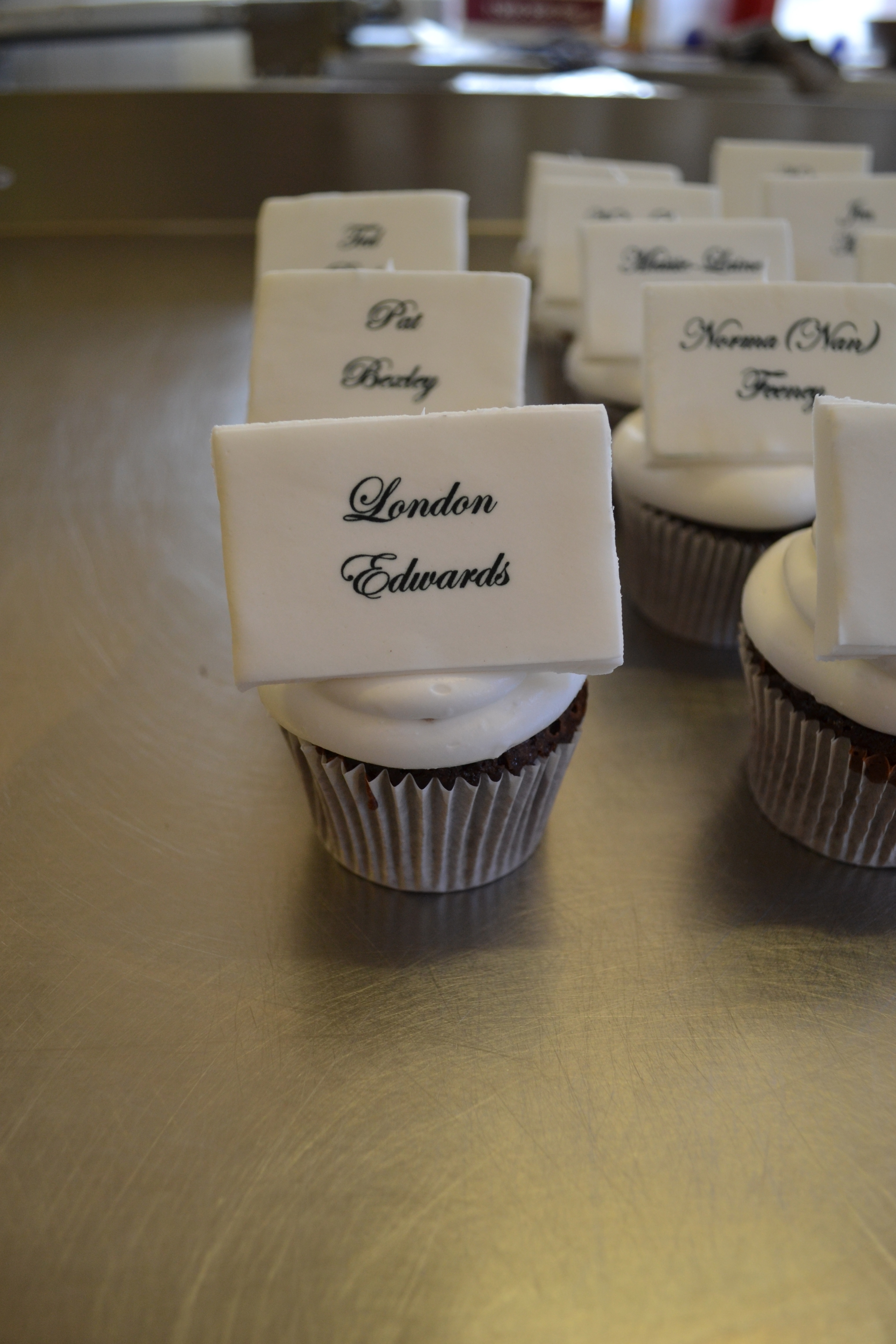 Personalised wedding guest cupcakes.