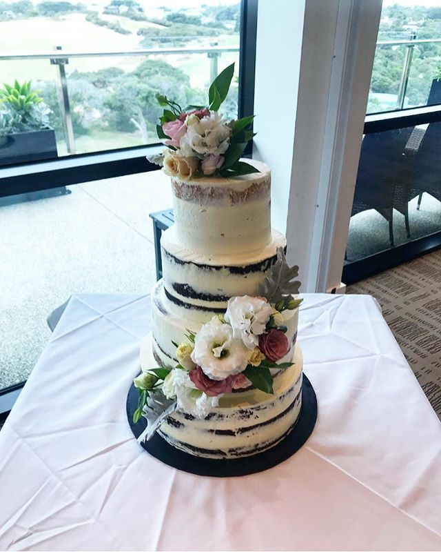 Stunning 4 tier semi naked cake with flo